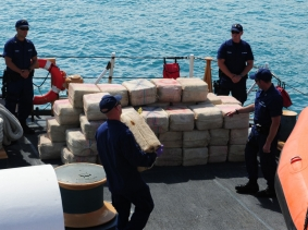 U.S. Coast Guardsmen unload 3,500 pounds of cocaine seized from a vessel in the Caribbean valued at an estimated $43 million in Miami, March 16, 2012
