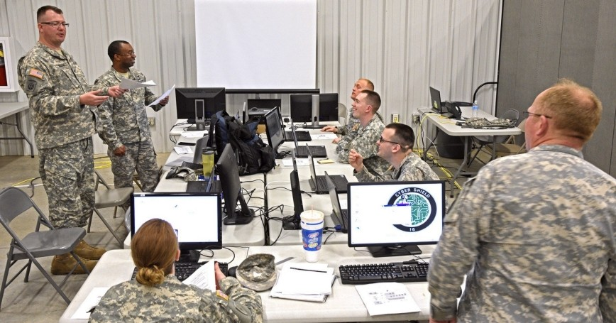 The Indiana National Guard Computer Network Defense Team readies their workstations for the Cyber Shield 2016 exercise at Camp Atterbury, Indiana, April 20, 2016