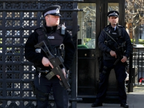 Armed police officers stand at the Carriage Gates entrance to the Houses of Parliament, following the attack in Westminster earlier in the week, in London, Britain March 25, 2017