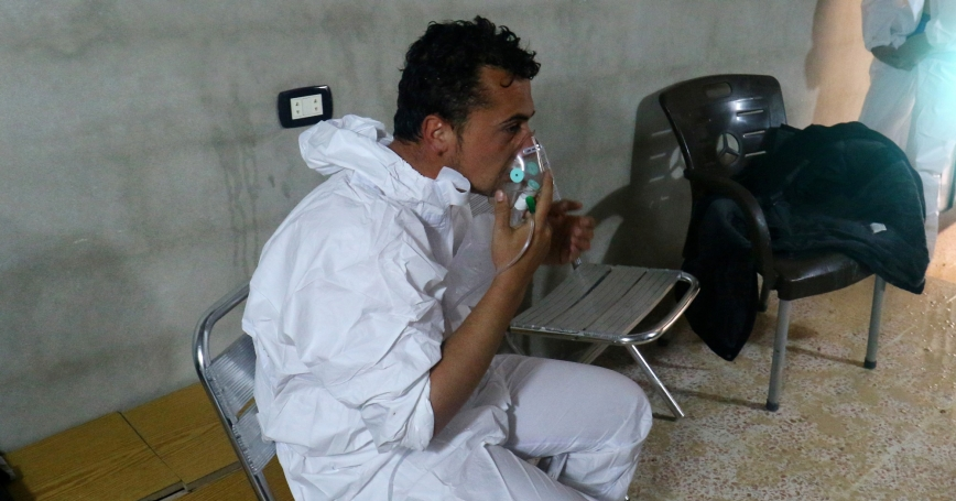 A man breathes through an oxygen mask, after what rescue workers described as a suspected gas attack in the town of Khan Sheikhoun in rebel-held Idlib, Syria April 4, 2017.