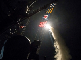 The guided-missile destroyer USS Ross fires a Tomahawk land attack missile April 7, 2017