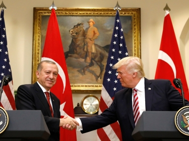 Turkey's President Recep Tayyip Erdogan (left) shakes hands with U.S President Donald Trump in the Roosevelt Room of the White House, May 16, 2017