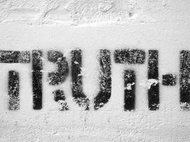The word truth in fading black paint