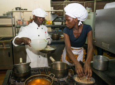 Youth foodies Ojangole Max Igune and Regina Nantege create a recipe at the October 2017 Superfoods cook-off in Kampala, Uganda