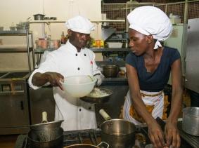 Youth foodies Ojangole Max Igune and Regina Nantege create a recipe at the October 2017 Superfoods cook-off in Kampala, Uganda