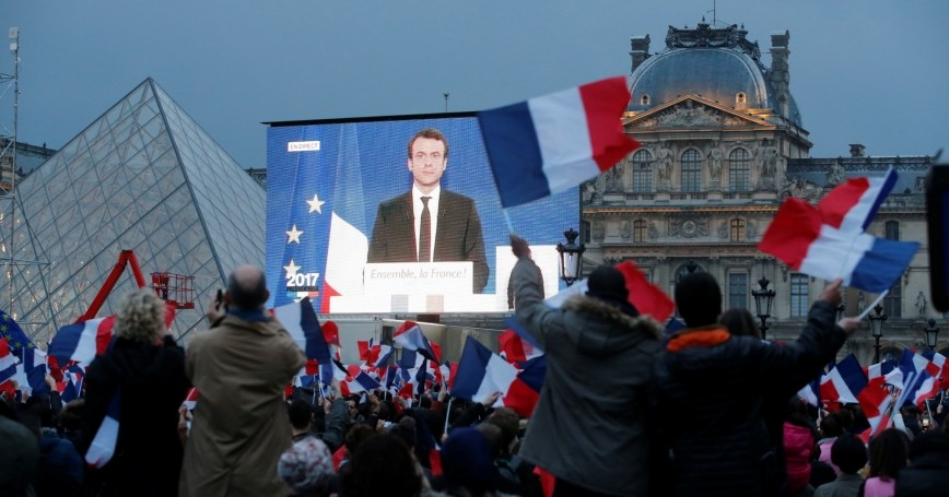 President-elect Emmanuel Macron is seen on a giant screen near the Louvre museum in Paris, France, May 7, 2017
