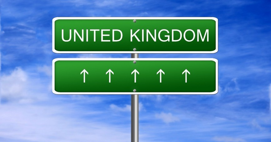 Sign with arrows pointing direction to the United Kingdom