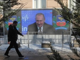A screen, showing Russian President Vladimir Putin's annual end-of-year news conference, is on display in Simferopol, Crimea, December 23, 2016.