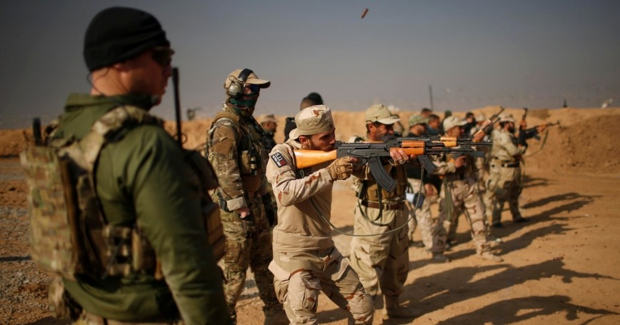 U.S. Army Special Forces members train Iraqi fighters from Hashid Shaabi at Makhmur camp in Iraq, December 11, 2016
