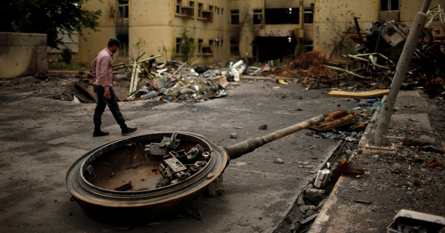 An Iraqi security guard walks inside Al-Salam hospital destroyed during the fighting between Iraqi forces and Islamic State militants east of Mosul, Iraq May 2, 2017.