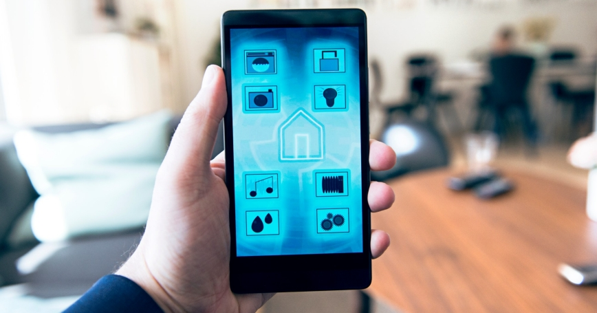 A mobile phone with an app to control wireless devices in a smart home like a washing machine, security camera, door lock, and music player