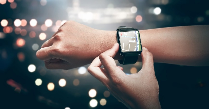 Person consulting a smart watch with GPS technology