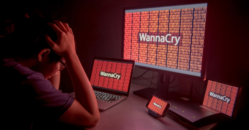 A young man is frustrated by the WannaCry ransomware attack