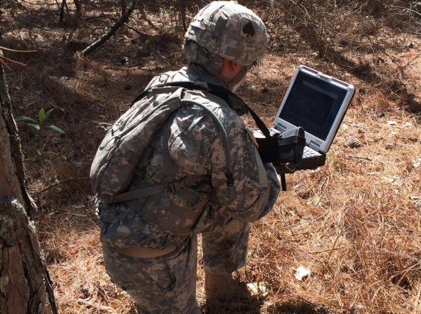 A student in the Army's first Cyber Basic Officer Leader Course uses a field computer to probe for a targeted wireless network signal during a field training exercise at Fort Gordon, Georgia, February 1, 2017