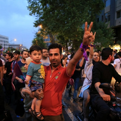 Supporters of Iran's President Hassan Rouhani celebrate his victory in the election, in Tehran, Iran, May 20, 2017