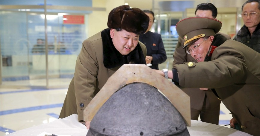 North Korean leader Kim Jong Un looks at a rocket warhead tip after a simulated test of atmospheric re-entry of a ballistic missile in this undated photo released by the Korean Central News Agency on March 15, 2016