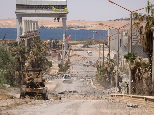 Vehicles drive near Tabqa Dam on the Euphrates River, in the town of Tabqa, after Syrian Democratic Forces (SDF) captured it from Islamic State militants, Syria May 12, 2017