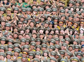 War veterans and commanding officers in a military parade celebrate the 60th anniversary of the signing of the truce of the Korean War, in Pyongyang, August 3, 2013