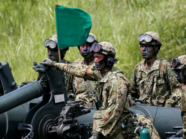 Japanese Ground Self-Defense Force soldiers take part in  an annual training session near Mount Fuji at Higashifuji training field in Gotemba, west of Tokyo, August 25, 2016
