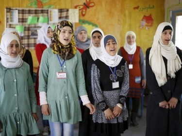 Syrian refugee Omayma al Hushan (2nd R), 14, who launched an initiative against child marriage among Syrian refugees, and her friends rehearse a play about it at a school in Al Zaatari refugee camp, Mafraq, Jordan, April 21, 2016