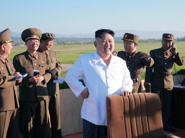 North Korean leader Kim Jong Un watches the test of a new-type anti-aircraft guided weapon system organized by the Academy of National Defence Science, May 2017