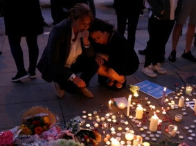 Two women pay their respects to victims of the bombing in Manchester, Britain, May 23, 2017