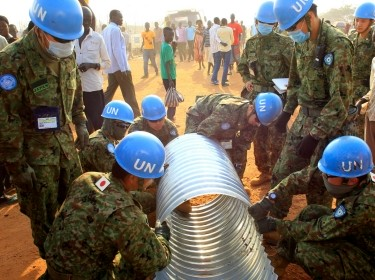 United Nations Mission in South Sudan peacekeepers from Japan assemble a drainage pipe at Tomping camp in Juba, January 7, 2014
