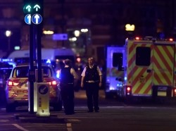 Police attend to an attack on London Bridge in Britain, June 3, 2017