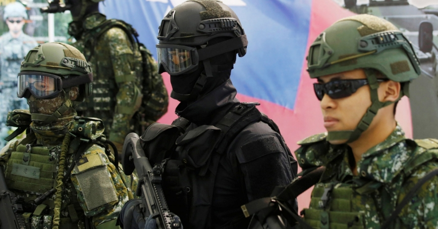 Soldiers pose for photo during International Maritime and Defense Industry Exposition in Kaohsiung, Taiwan September 16, 2016
