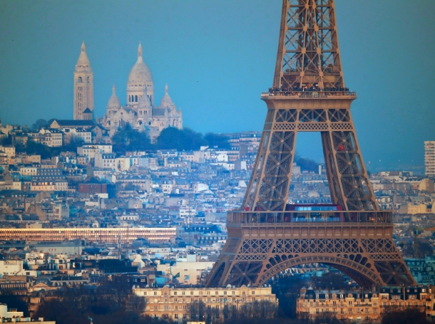 The Eiffel Tower is seen in front of the Sacre Coeur Basilica on Montmartre in Paris, France, during the 2015 World Climate Change Conference