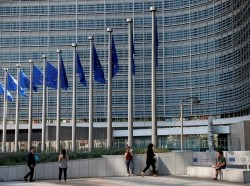 People are pictured outside the European Commission headquarters in Brussels, Belgium June 14, 2017.