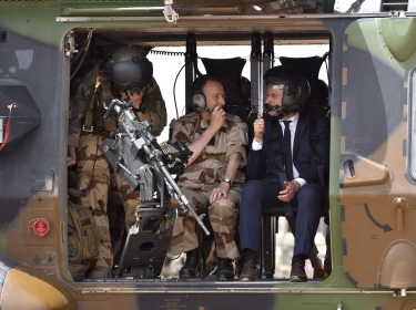 French President Emmanuel Macron rides in a helicopter as he visits French troops in Africa's Sahel region in Gao, northern Mali, 19 May 2017.