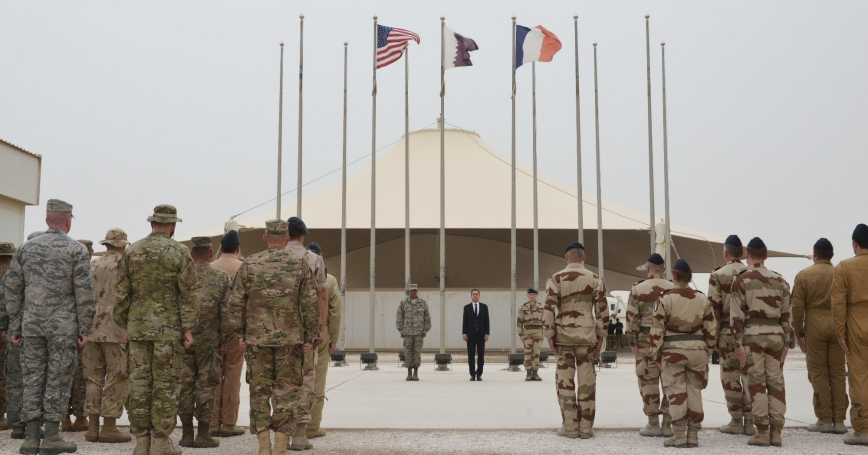 Coalition Forces commanders and Combined Air Operations Center members attend a Bastille Day ceremony at Al Udeid Air Base, Qatar, July 14, 2015
