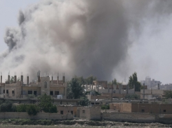 Smoke rises from the al-Mishlab district in Raqqa's southeastern outskirts, Syria, June 7, 2017