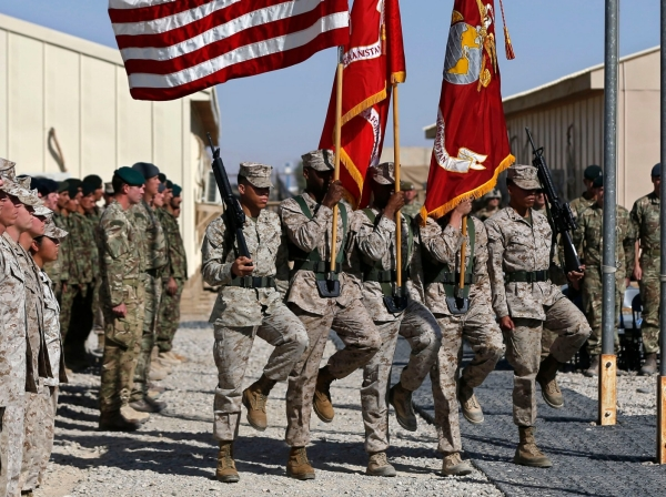 U.S. Marines, British and Afghan troops attend a handover ceremony in Helmand province, October 26, 2014