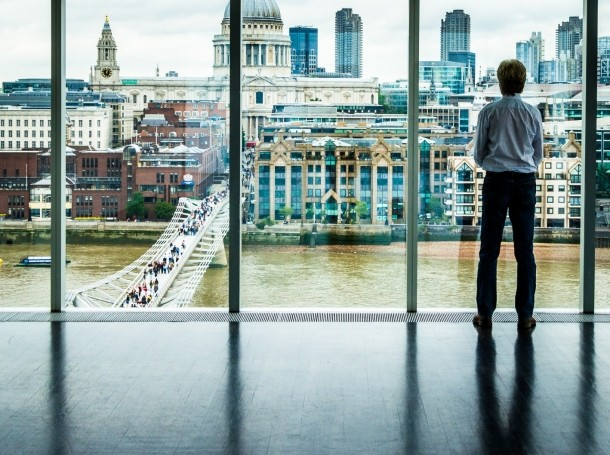 A businessman looking out at the modern London skyline