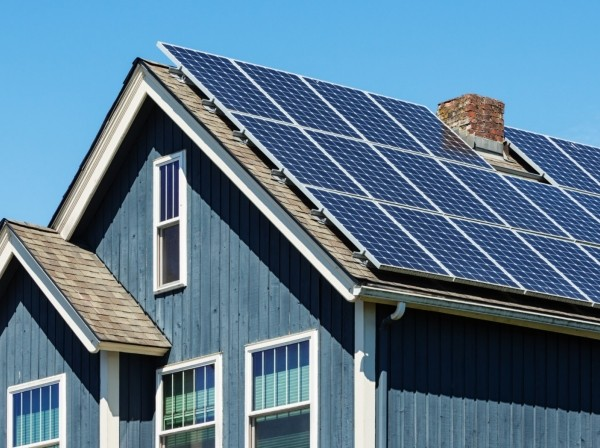 A house with energy-efficient solar panels on the roof