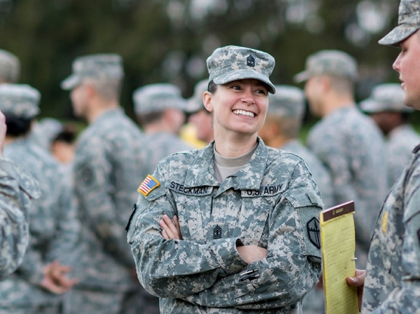 First Sgt. Raquel Steckman, with the 374th Engineer Company (Sapper), headquartered in Concord, California, jokes with her Soldiers before the start of formation.