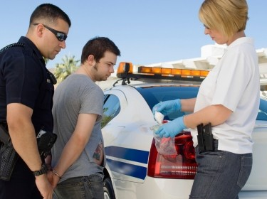 A man being arrested for drug possession