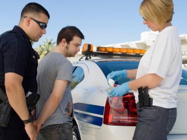 A man being arrested for drug possession