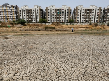 Residential apartments next to the dried-up Ratanpura lake on the outskirts of Ahmedabad, India May 9, 2016