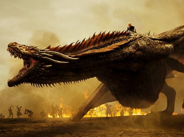 Daenerys Targaryen rides her dragon into battle in a scene from the 'Spoils of War' episode of 'Game of Thrones'