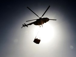 A U.S. contractor's MI-8 helicopter carries supplies to Camp Nathan Smith in Kandahar May 27, 2010.