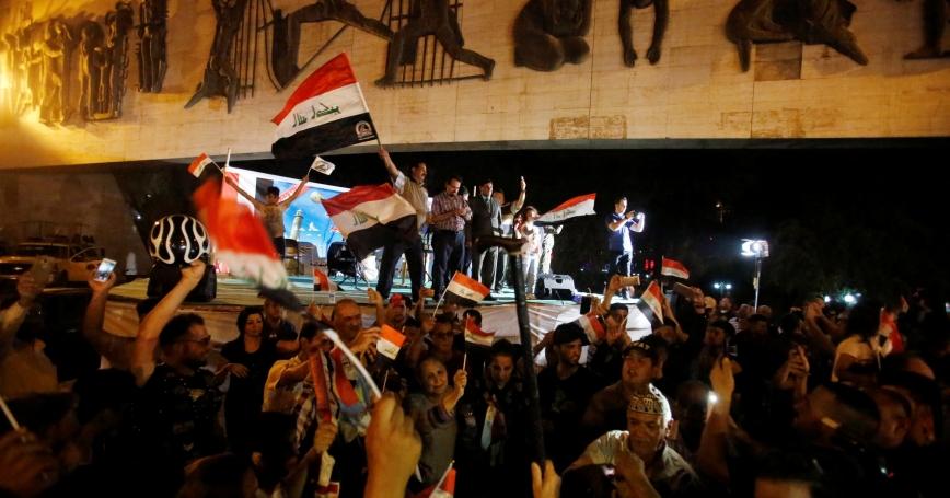 Iraqis celebrate as Prime Minister Haider al-Abadi announces victory over Islamic State in Mosul, in Baghdad, Iraq, July 10, 2017