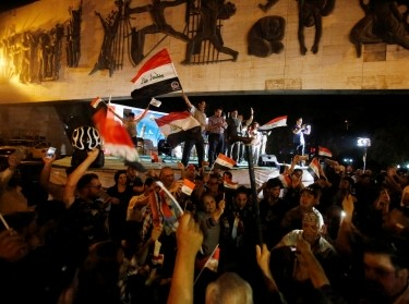 Iraqis celebrate as Prime Minister Haider al-Abadi announces victory over Islamic State in Mosul, in Baghdad, Iraq, July 10, 2017