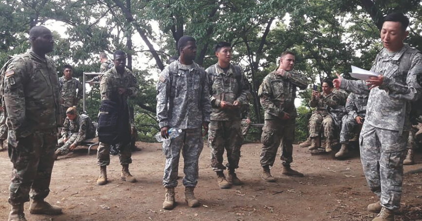 Soldiers hike up Pinnacle 4, a mountain near Camp Humphreys, for a history lesson on the Korean War and team building for U.S.-ROK forces, June 2017