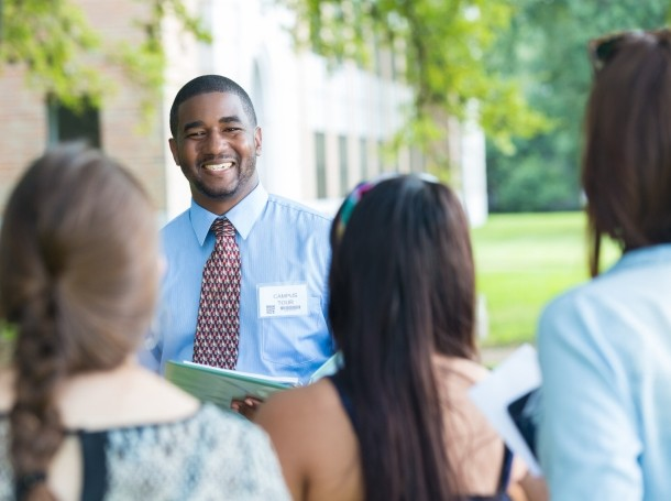 College campus tour guide talking with prospective students