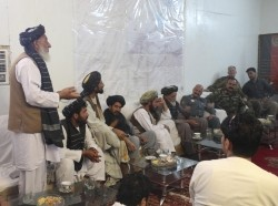 An Afghan tribal elder speaks to key leaders with the National Police, Afghan National Army, and Task Force Southwest during a shura at Camp Nolay, Helmand, Afghanistan, May 25, 2017