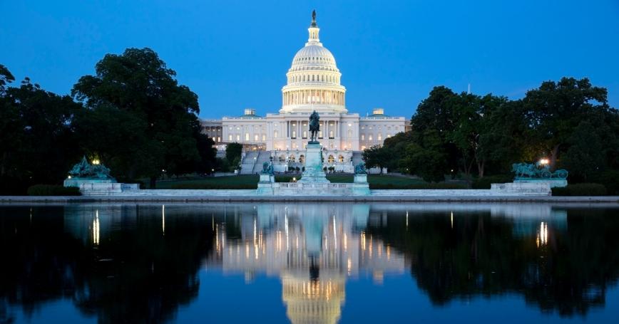 The U.S. Capitol building illuminated at night in Washington, D.C.