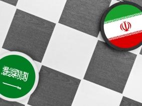 A checkers game depicting Saudi Arabia vs. Iran